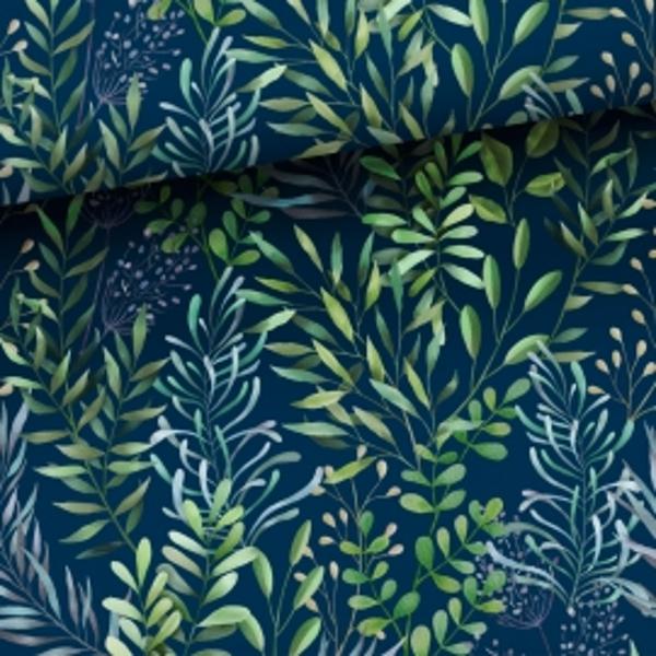 Zaļas lapiņas uz tumši zila