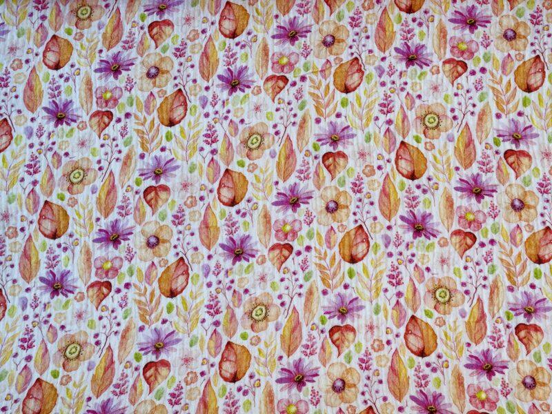 Muslins - maigi oranži rozīgās puķes