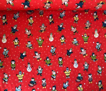 Ziemas prieki pingvīniem uz sarkana fona